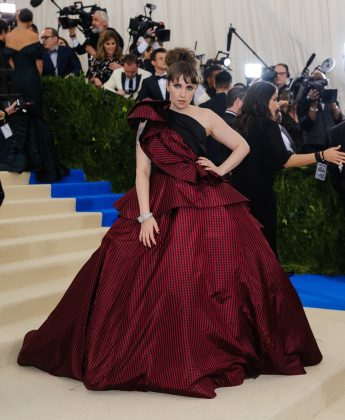 Lena Dunham attended the 2017 Met Gala in a one-shouldered, red-and-black-checcked ball gown designer by Elizabeth Kennedy. (Photo: WENN)
