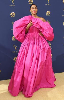 Tracee Ellis Ross took awards season dressing to the next level when she attended the 2018 Emmy Awards in a shockingly huge hot pink dress by Valentino. (Photo: WENN)