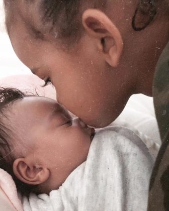 Saint West planting an adorable kiss on her baby sister's nose. (Photo: Instagram)