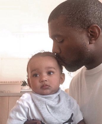 Loving daddy Kanye planting a sweet kiss on Chicago's head. (Photo: Instagram)