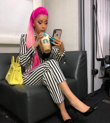 Cardi B took a quick coffee break sporting a bright colored-hairstyle that contrasted with her highlighter yellow neon bag. (Photo: Instagram)