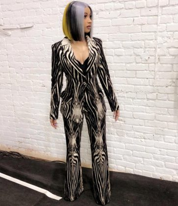 Cardi perfectly coordinated with her animal-printed suit by doing the same with her hair. (Photo: Instagram)