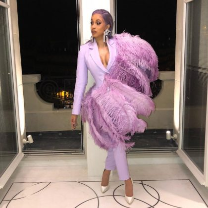 Sophisitcated yet fun, Cardi worked a more serious look but with fun-colored slick-back locks. (Photo: Instagram)