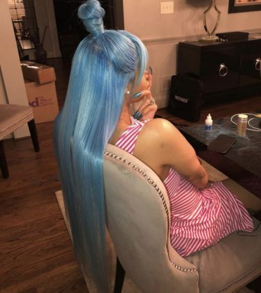 Cardi B posed for a photo showcasing her blue, top-knot do. (Photo: Instagram)