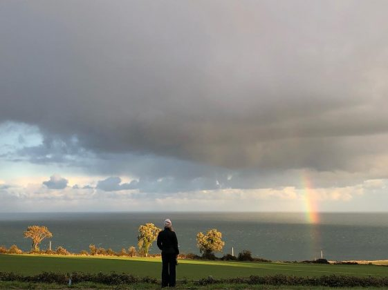 """Looking forward,"" wrote Amanda Seyfreid on this picture of her staring at a beautiful rainbow. (Photo: Instagram)"