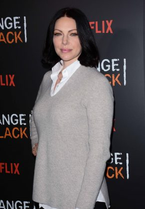 """This natural blonde dyed her hair red for """"That 70's Show."""" She then went even darker for her role as Alex in """"Orange is the New Black."""" And now we can't picture Laura without her jet-black locks! (Photo: WENN)"""