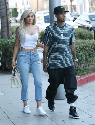 Rapper Tyga (24) first started popping on Kylie Jenner's Instagram when she was just 14! This fueled all kinds of speculation about their relationship, which Kanye spilled the beans on in a radio interview. (Photo: WENN)