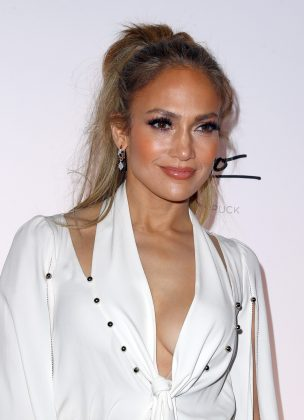 "Jennifer Lopez said in regards to drinking alcohol or smoking: ""I think it ruins your skin."" Jenny also explained ""During celebratory toasts, everybody's like, 'you can't toast with water!' So I'll toast with alcohol and just take a sip."" (Photo: WENN)"