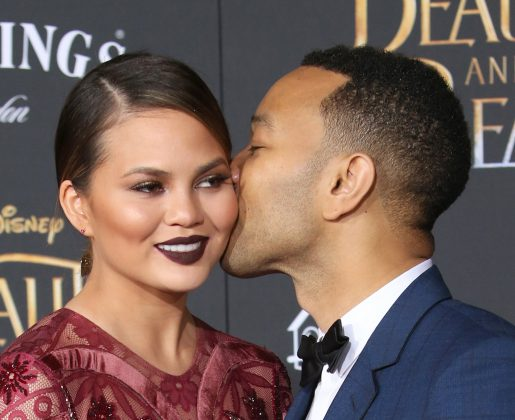 Chrissy Teigen and John Legend got into their biggest fight ever at Kim and Kanye's wedding. (Photo: WENN)