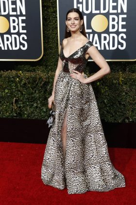 "Anne Hathaway's impeccable looks from ""Ocean's 8"" were nowhere to be fond on the Globs carpet, with the actress opting for a misguided leopard travesty. (Photo: WENN)"
