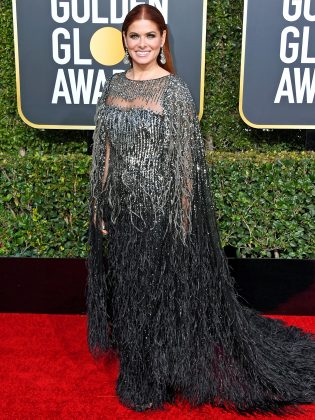 With a little tailoring, Debra Messing's dress perhaps could've been a winner. In reality, her look just resembled a sparkled, feather, black-tie muumuu. (Photo: WENN)