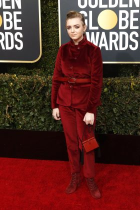 Elsie Fisher was dressed decades older in an unflattering maroon pantsuit and boots combo. (Photo: WENN)
