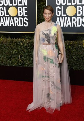 Lucy Liu ins undeniably a national treasure, but her nude-colored gown with its neon splashes of color had the unintended effect of vaguely resembling a skin disease. (Photo: WENN)