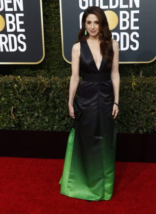 Looking a little too much like the Grinch went to prom, Marin Hinkle made an interesting choice with her Lanvin gown's black-green ombre. (Photo: WENN)