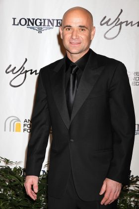 Tennis legend Andre Agassi wore a wig when baldness hit in the 900s. But he now embraces his bare scalp and opts for a close shave. And he looks better than ever! (Photo: WENN)