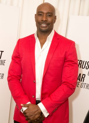 After Morris Chestnut shaved his head for a movie, he decided to keep the baldhead look. Best career move ever! (Photo: WENN)