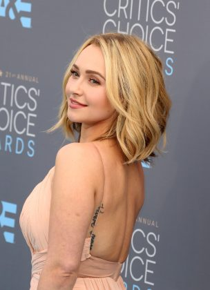 "Hayden Panettiere allegedly has the words ""live without regret"" incorrectly spelled in Italian on her side. Oops! (Photo: WENN)"