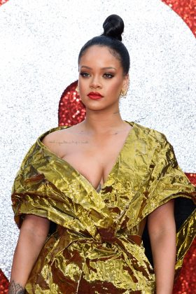Rihanna is reportedly asking for damages from her father and an injunction on his business. (Photo: WENN)