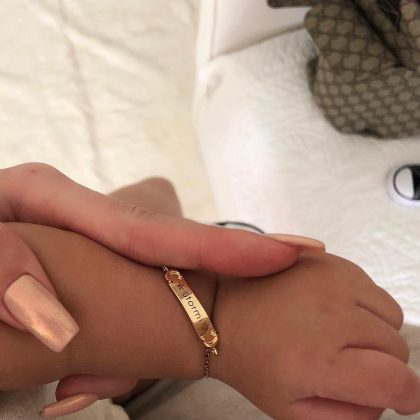 Kylie Jenner showed off ger daughter's newest bling—a gold personalized nameplate bracelet that reads Stormi. (Photo: Instagram)