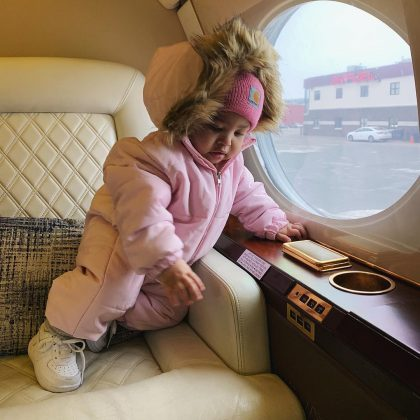 Stormi took on the cold of chilly Minnesota in an adorable pale pink snowsuit featuring a plush, fur-lined hood and a pink beanie. (Photo: Instagram)