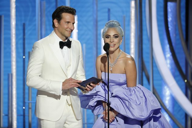 Of course, the most perfect on-screen pair had to be the most perfect IRL hosting pair. (Photo: WENN)