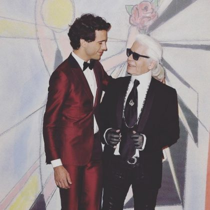"Musician Mika recalled the firs time he met Karl. ""I told him I liked the pattern he had designed for the table cloths. So, he picked up the end of it and cut me a tie, asking me to wear it that evening."" (Photo: Instagram)"