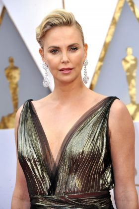 "Charlize Theron was deported from the US in 1994 at age 19. Her career was just taking off and she had landed a role in 'The Devil's Advocate,"" when immigration found her. She was eventually let back in and became a US citizen in 2007. (Photo: WENN)"