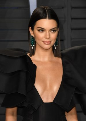 "Kendall Jenner—""I think a strong woman is independent, don't need no man and can walk into a room by herself and not be bothered."" (Photo: WENN)"