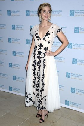 "Blunt attended the ""Freeing Voices Changing Lives"" benefit gala wearing a plunging white dress covered with a black-floral print design. (Photo: WENN)"