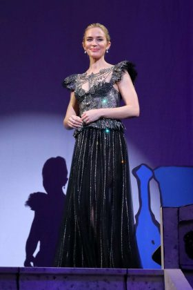 "The actress wore a silver beaded Gucci dress with a peplum top to the premiere of ""Mary Poppins Returns"" in Tokyo, Japan. (Photo: WENN)"