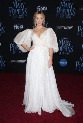 "Emily Blunt looked radiant in a billowing Yanina Couture white gown as she arrived at the world premiere of her Disney movie ""Mary Poppins Returns."" (Photo: WENN)"
