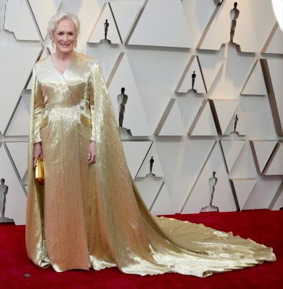 Looking liken an actual Oscar, Glenn Close opted for a head-to-toe gold Carolina Herrera gown. (Photo: WENN)