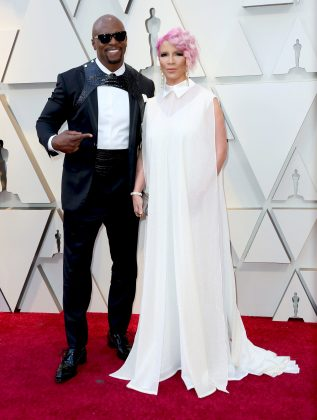 Terry Crews' harness shined, not dimmed, in comparison to his wife Rebecca King-Crew's pink hair. (Photo: WENN)