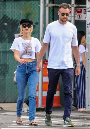 He is TALL. JLaw is five-foot-nine. So, judging by their picture together, we'd put him at at least six-foot-four. (Photo: WENN)