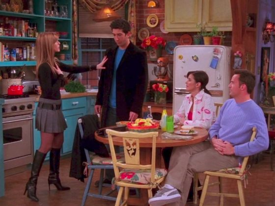 Only Rachel Green could simultaneously wear black turtleneck, pleated miniskirt, and stiletto boots and made it look good! (Photo: Release)