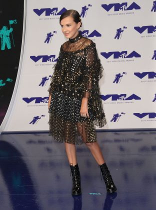 Millie Bobby Brown dazzled in the MTV VMA 2017 red carpet in an embellished tulle dress with lace-up patent leather boots. (Photo: WENN)