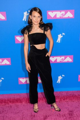 Millie attended the 2018 VMA's in an all-black Rosie Assoulin ensemble incorporating elements of menswear with a flourish of femininity in the tulle shoulder poufs. (Photo: WENN)