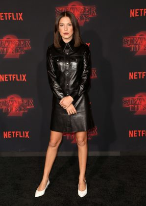 Millie Bobby Brown cut a chic figure in an all-black short leather shirt dress at the premiere of the second season of 'Stranger Things.' (Photo: WENN)