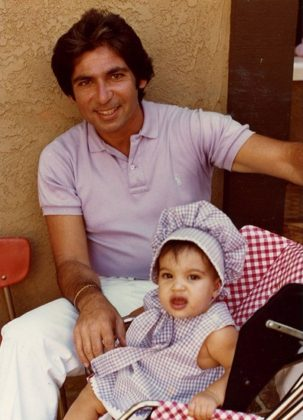 Robert Kardashian and baby Kim in matching lilac outfits. (Photo: Instagram)