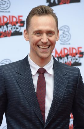 I mean—Tom's smile alone is gift from the gods! (Photo: WENN)