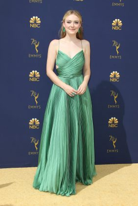 Dakota Fanning dazzled in a pleated mint green gown by Dior at the 2018 Emmy Awards ceremony. (Photo: WENN)