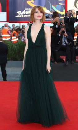 Emma Stone attended the opening ceremony and 'Birdman' premiere during the 71st Venice Film Festival 2014 in a plunging emerald green Valentino gown. (Photo: WENN