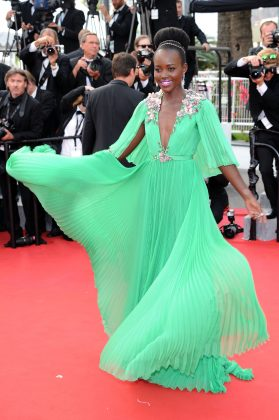 "Lupita arrived at the opening ceremony and premiere of ""Standing Tall"" during the 2015 Cannes Film Festival wearing a deep V-neck Gucci dress. (Photo: WENN)"