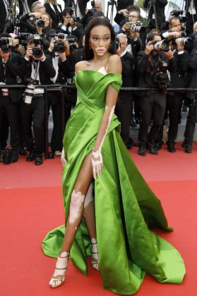 "Winnie Harlow wowed in a metallic green dress by Jean Louis Sabaji as she arrived at the Cannes premiere of ""BlacKkKlansman."" (Photo: WENN)"