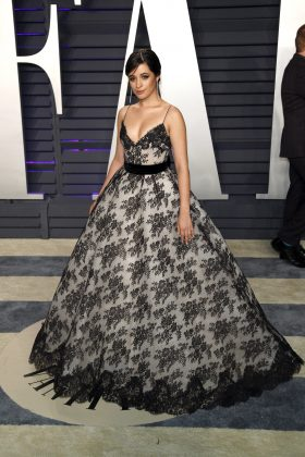 Camila was a vision at the Vanity Fair 2019 Oscar Party in her big romantic black and white lace ball gown by Monique Lhuillier. (Photo: WENN)
