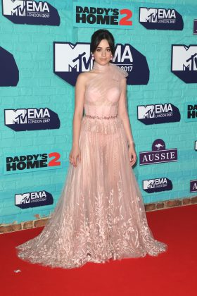 Camila Cabello flashed her assets in a sexy, sheer bush pink gown featuring a tulle high bow on the neck and floral embroidery. (Photo: WENN)
