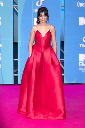 Cabello dazzled in a fiery red gown with pockets at the MTV European Music Awards 2018. (Photo: WENN)