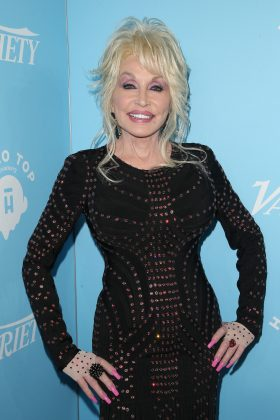 "Dolly Parton has been married to her husband, Carl Thomas Dea, for over 50 years. And she's often joked about her view on monogamy. ""If we cheat, we don't know it, so if we do cheat, it's very good for both of us."" (Photo: WENN)"