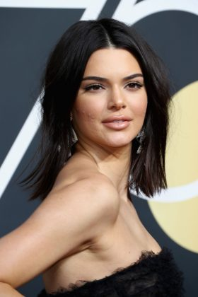 Even though she faced backlashed for her over-hyped partnership with Proactive, Kendall Jenner has suffered of very visible acne. She even walked down the Golden Globe's red carpet with her face covered in zits. (Photo: WENN)