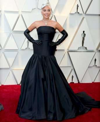 Lady Gaga became an Oscar winner in an Alexander McQueen black strapless dress and the legendary 128 carat Tiffany diamond. (Photo: WENN)